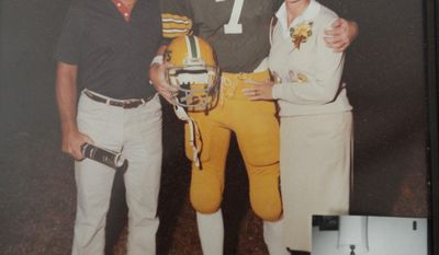 Jay, shown with his father Jim and mother Kathy, played quarterback at Chamberlain High School in Tampa. (Cliff McBride/SPECIAL TO THE WASHINGTON TIMES)