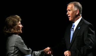 Republican candidate for Senate Thom Tillis (right) and Concerned Veterans for America been airing attack ads targeting incumbent Democratic Sen. Kay Hagan for the conditions of VA facilities in North Carolina, but analysts say the issue will have little impact on the race. (Associated press)