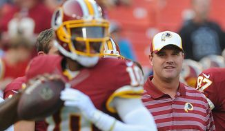 Redskins coach Jay Gruden said it's his job to get the most out of quarterback Robert Griffin III and there needs to be an open relationship and trust between the two of them. (Preston Keres/Special To The Washington Times)