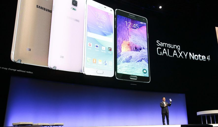 DJ Lee, Executive Vice President of Samsung,  presents a Samsung Galaxy Note 4 during his keynote speech at an unpacked event of Samsung ahead of  the consumer electronic fair IFA in Berlin, Wednesday, Sept. 3, 2014. (AP Photo/Markus Schreiber)