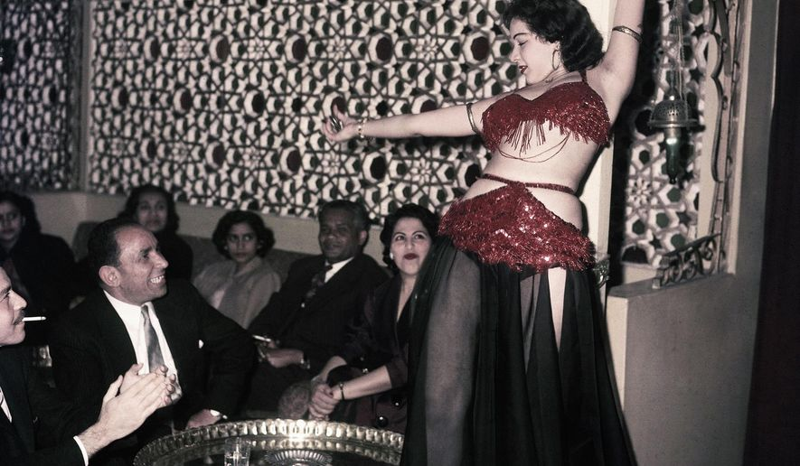 """FILE - In this March 25, 1956 file photo, Ferial, a belly dancer, performs at the Abdin Casino in Cairo, Egypt. Egypt's top religious body has demanded Wednesday, Sept. 3, 2014 a new belly-dancing TV show be suspended for """"corrupting morals"""" and serving """"extremists"""" who could use it as a pretext to depict Egyptian society as anti-Islamic.(AP Photo, File)"""