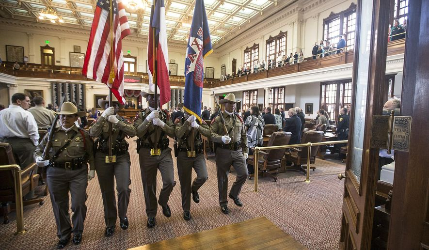 Members of the Texas Highway Patrol Honor Guard hold flags during the Stars of Texas awards ceremony at the State Capitol in Austin, Texas on Wednesday, Sept. 3, 2014. (AP Photo/Austin American-Statesman, Ricardo B. Brazziell)