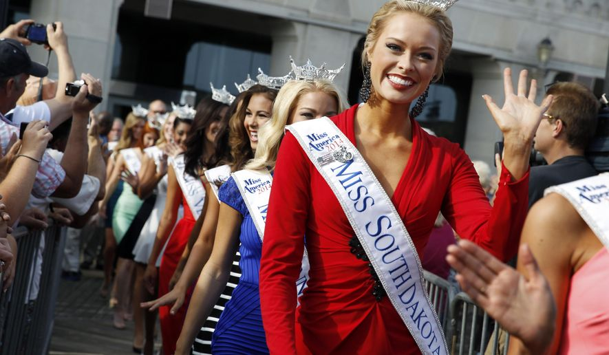 Miss South Dakota Meridith Gould waves during Miss America Pageant arrival ceremonies Wednesday, Sept. 3, 2014, in Atlantic City, N.J. Miss America contestants from all 50 states, the District of Columbia, Puerto Rico and the U.S. Virgin Islands will appear Wednesday afternoon at the traditional welcoming ceremony across from Boardwalk Hall. (AP Photo/Mel Evans)