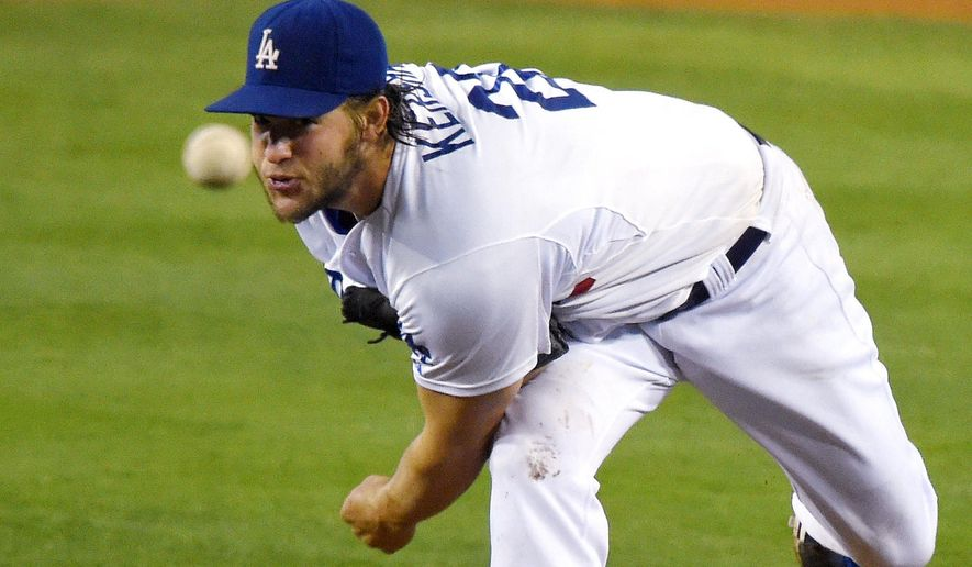 Los Angeles Dodgers starting pitcher Clayton Kershaw throws to the plate during the fourth inning of a baseball game against the Washington Nationals, Tuesday, Sept. 2, 2014, in Los Angeles. (AP Photo/Mark J. Terrill)