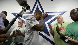 Dallas Cowboys practice squad player defensive end Michael Sam arrives to speak to reporters after team practice at the team's headquarters Wednesday, Sept. 3, 2014, in Irving, Texas. (AP Photo/LM Otero)