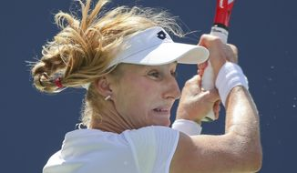 Ekaterina Makarova, of Russia, follows through on a shot against Victoria Azarenka, of Belarus, during the quarterfinals of the 2014 U.S. Open tennis tournament, Wednesday, Sept. 3, 2014, in New York. (AP Photo/Mike Groll)