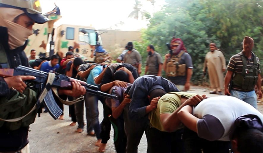 "FILE - This file image posted on a militant website on Saturday, June 14, 2014, which has been verified and is consistent with other AP reporting, appears to show militants from the Islamic State group leading away captured Iraqi soldiers dressed in plain clothes after taking over a base in Tikrit, Iraq. Human Rights Watch, a leading international watchdog, said Wednesday, Sept 3, 2014, new evidence indicates the Islamic State fighters killed between 560 and 770 men captured at Camp Speicher, near the city of Tikrit — a figure several times higher than what was initially reported. The Human Rights Watch statement said the revised figure for the slain soldiers was based on analysis of new satellite imagery, militant videos and a survivor's account that confirmed the existence of three more ""mass execution sites.""  (AP Photo via militant website, File)"