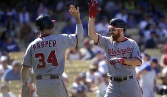 Washington Nationals' Adam LaRoche, right, celebrates his two-run home run with Bryce Harper during the ninth inning of a baseball game against the Los Angeles Dodgers on Wednesday, Sept. 3, 2014, in Los Angeles. (AP Photo/Jae C. Hong)