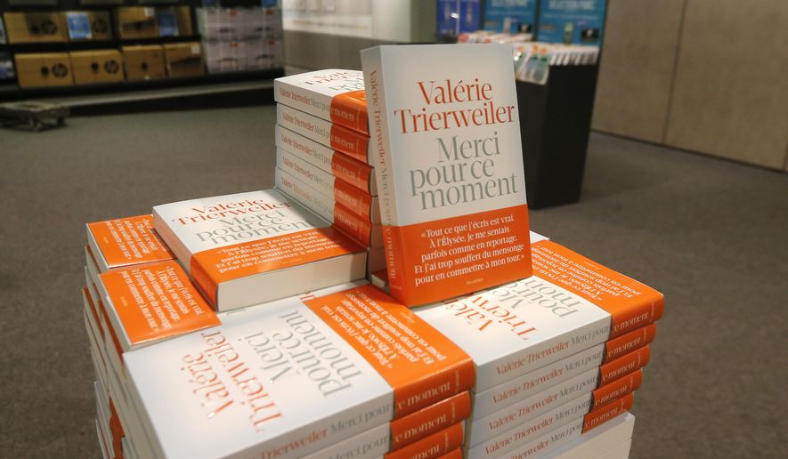 "A pile of former French first lady Valerie Trierweiler's book ""Thank You for this Moment"", is pictured in a Paris bookstore, France, Thursday, Sept. 4, 2014. The former companion of French President Francois Hollande writes in a book that the Socialist presents himself as someone who doesn't like the rich, but in fact ""doesn't like the poor."" The couple broke up in January amid reports Hollande was having an affair with actress Julie Gayet. The book risks further damaging the image of the already deeply unpopular president even though the French had little love for Trierweiler, who couldn't find her place as first lady. (AP Photo/Jacques Brinon)"