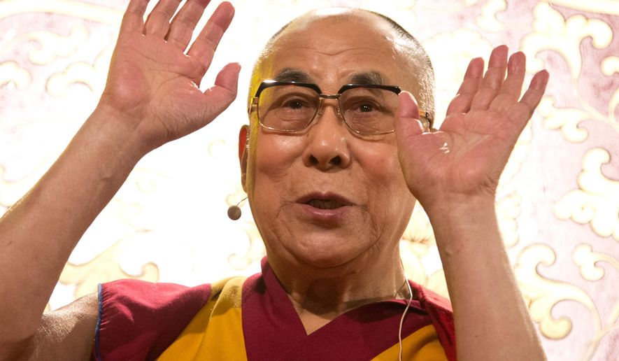 File: In this Aug. 26 2014 file photo Tibetan spiritual leader the Dalai Lama, during a visit to Hamburg Germany. The Dalai Lama's South Africa representative says that he has again been refused entry into the country to attend the 14th World Summit of Nobel Peace Prize Laureates in Cape Town, South Africa next month. (Christian Charisius/picture-alliance/dpa/AP Images-File)