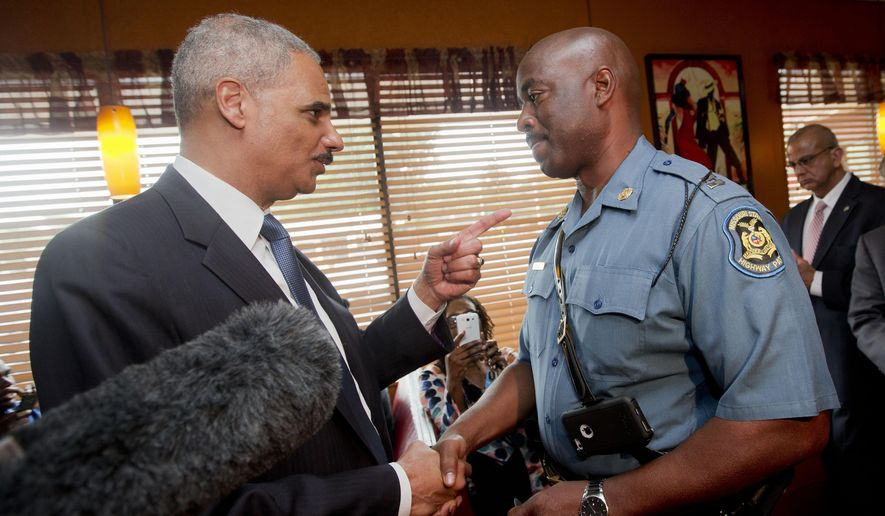 FILE - In this Aug. 20, 2014 file photo, Attorney General Eric Holder talks with Capt. Ron Johnson of the Missouri State Highway Patrol at Drake's Place Restaurant in Florrissant, Mo.  The Justice Department plans to open a wide-ranging investigation into the practices of the Ferguson, Missouri, Police Department following the shooting last month of an unarmed black 18-year-old by a white police officer in the St. Louis suburb, a person briefed on the matter said Wednesday, Sept. 3, 2014.  (AP Photo/Pablo Martinez Monsivais, File-Pool)