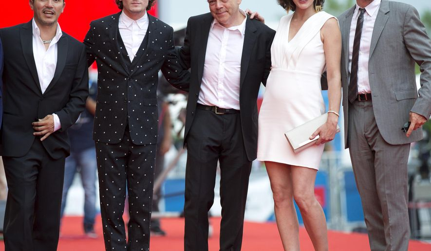 From right, actor Ethan Hawk, actress Milla Jovovich, director Michael Almereyda, actor Anton Yelchin and actor John Leguizamo pose for photographers as they arrive for the screening of Cymbeline at the 71st edition of the Venice Film Festival in Venice, Italy, Wednesday, Sept. 3, 2014.  (AP Photo/Andrew Medichini)