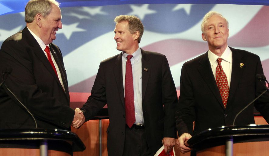 Republicans seeking their party's nomination in next weeks state primary, from left, former U.S. Sen. Bob Smith, former state Sen. Jim Rubens and former U.S. Sen. from Massachusetts Scott Brown greet each other before a televised debate Thursday Sept. 4, 2014 at WMUR in Manchester, N.H. The winner of next weeks state primary will try to unseat incumbent Democrat Jeanne Shaheen. (AP Photo/Jim Cole)