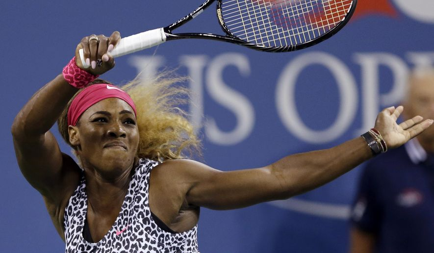 Serena Williams, of the United States, returns a shot to Flavia Pennetta, of Italy, during the quarterfinals of the U.S. Open tennis tournament Wednesday, Sept. 3, 2014, in New York. (AP Photo/Darron Cummings)