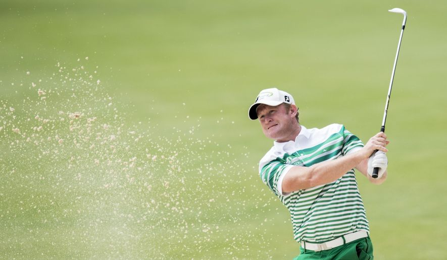 Jamie Donaldson of Wales plays a ball at  hole 9 during the first round of the Omega European Masters Golf Tournament in Crans-Montana, Switzerland, Thursday, Sept. 4, 2014. (AP Photo/Keystone,Ennio Leanza)