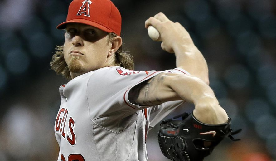 Los Angeles Angels' Jered Weaver winds up on a pitch to the Houston Astros in the first inning of a baseball game Wednesday, Sept. 3, 2014, in Houston. (AP Photo/Pat Sullivan)