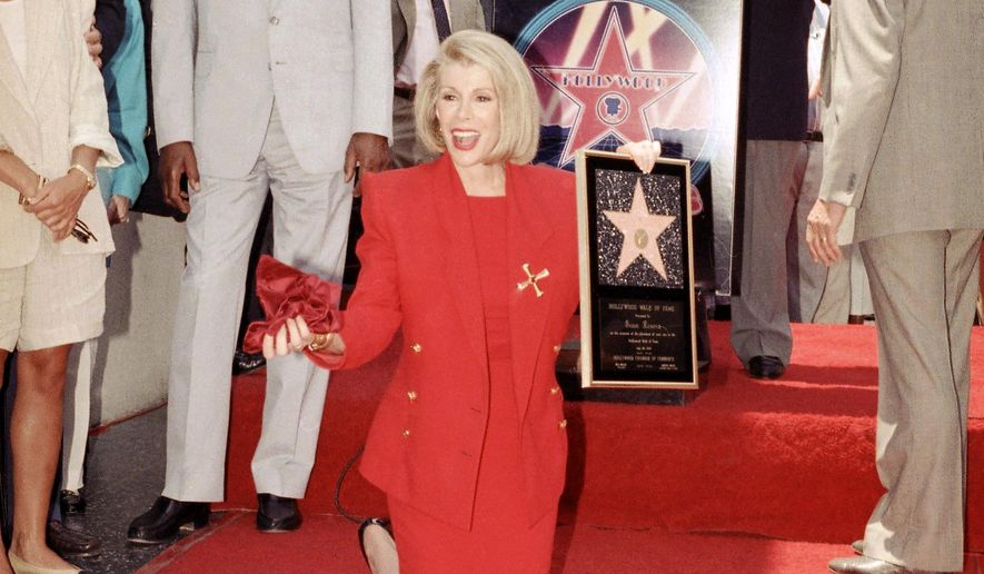 FILE - In this July 26, 1989 file photo, comedian Joan Rivers poses next to her star on the Hollywood Walk of Fame during her induction ceremony in Los Angeles. Rivers, the raucous, acid-tongued comedian who crashed the male-dominated realm of late-night talk shows and turned Hollywood red carpets into danger zones for badly dressed celebrities,  died Thursday, Sept. 4, 2014. She was 81. Rivers was hospitalized Aug. 28, after going into cardiac arrest at a doctor's office.  (AP Photo/Doug Sheridan, File)