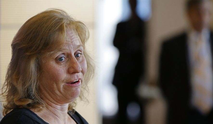 Debbie Sacra, wife of Dr. Rick Sacra, an American doctor who contracted the Ebola virus in Africa, addresses members of the media at the University of Massachusetts Medical School Thursday Sept. 4, 2014 in Worcester, Mass. (AP Photo/Stephan Savoia)