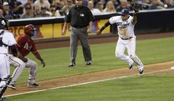San Diego Padres third baseman Yangervis Solarte, right, misses the throw back to third as Arizona Diamondbacks' Didi Gregorius, left, is caught off base during the fifth inning of a baseball game Wednesday, Sept. 3, 2014, in San Diego. Gregorius scored and Solarte picked up an error on the play. (AP Photo/Gregory Bull)