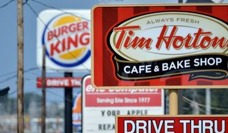 Burger King's deal to buy Tim Hortons and move its headquarters will allow the fast-food giant to reap the benefits of lower corporate tax rates in Canada. The accelerating pace of tax inversion deals is sending a signal that the U.S. needs to overhaul its corporate tax code. (associated press)
