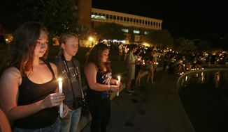 Students and supporters take part in a candle light vigil at the University of Central Florida, Wednesday, Sept. 3, 2014, in Orlando, Fla., to honor Steven Sotloff, the second American journalist to be beheaded by the Islamic State group in two weeks. Sotloff attended University of Central Florida between 2002 and 2004. (AP Photo/John Raoux)