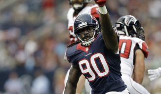 FILE - In this Aug. 16, 2014, file photo, Houston Texans' Jadeveon Clowney (90) celebrates after he sacked Atlanta Falcons' Matt Ryan (2) during the first quarter of an NFL preseason football game  in Houston.  (AP Photo/Patric Schneider, File)