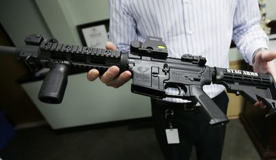 Mark Malkowski, President of Stag Arms, holds an AR-15 built at his company in New Britain, Conn., Wednesday, April 10, 2013. (AP Photo/Charles Krupa) **FILE**