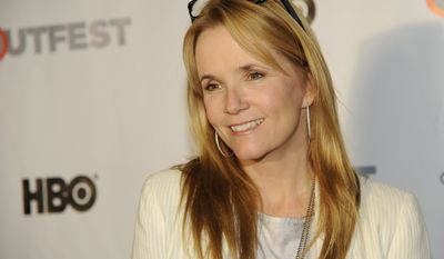 Actress Lea Thompson poses at the Outfest 2014 Fusion LGBT People of Color Film Festival in Los Angeles on March 15, 2014. (Chris Pizzello/Invision/Associated Press)