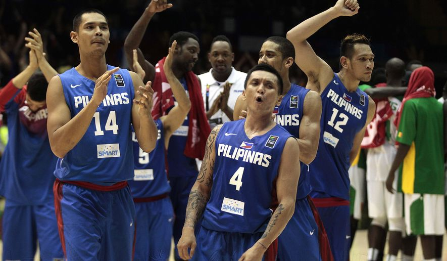 Philippines' Japeth Aguilar, left, and teammate Jim Alapag, right, celebrates after winning the match at the end of the match  against Senegal during the Group B Basketball World Cup match between the Philippines and Senegal in Seville, Spain, Thursday, Sept. 4, 2014. The 2014 Basketball World Cup competition will take place in various cities in Spain from Aug. 30 through to Sept. 14. (AP Photo/Miguel Angel Morenatti)
