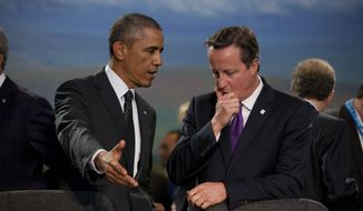 President Obama and British Prime Minister David Cameron at the start of a NATO-Afghanistan round table on Thursday in Newport, Wales. (AP Photo/Matt Dunham)