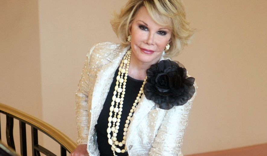 """FILE - This Oct. 5, 2009 file photo shows Joan Rivers posing as she presents """"Comedy Roast with Joan Rivers """" during the 25th MIPCOM (International Film and Programme Market for TV, Video, Cable and Satellite) in Cannes, southeastern France. Rivers, the raucous, acid-tongued comedian who crashed the male-dominated realm of late-night talk shows and turned Hollywood red carpets into danger zones for badly dressed celebrities,  died Thursday, Sept. 4, 2014. She was 81. Rivers was hospitalized Aug. 28, after going into cardiac arrest at a doctor's office.  (AP Photo/Lionel Cironneau, File)"""