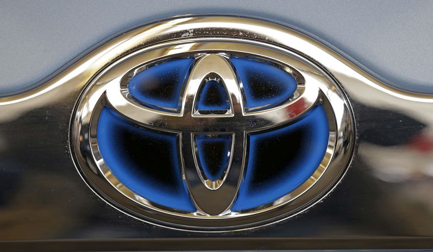 FILE - This Feb. 14, 2013 file photo shows the Toyota logo on the trunk of a Toyota automobile at the 2013 Pittsburgh Auto Show in Pittsburgh. Toyota executives on Thursday, Sept. 4, 2014 promised by 2017 to have collision-prevention technology installed across its U.S. line-up, in both mainstream and luxury vehicles. (AP Photo/Gene J. Puskar, File)