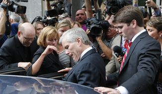 Former Virginia Gov. Bob McDonnell, center, is mobbed by media as he gets into a car with his son, Bobby, right, after McDonnell and his wife, former first lady Maureen McDonnell, were convicted on multiple counts of corruption at Federal Court in Richmond, Va., Thursday, Sept. 4, 2014. A federal jury in Richmond convicted Bob McDonnell of 11 of the 13 counts he faced; Maureen McDonnell was convicted of nine of the 13 counts she had faced. Sentencing was scheduled for Jan. 6.  (AP Photo/Steve Helber)