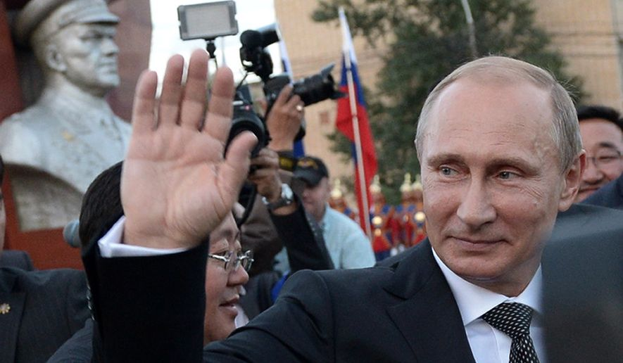 Russian President Vladimir Putin waves after a wreath laying ceremony at the monument to Soviet Marshal Georgy Zhukov in Ulan Bator, Mongolia, Wednesday, Sept. 3, 2014. As the Ukraine crisis intensifies, the NATO countries closest to Russia have been pushing the alliance to set up permanent bases with troops on their land _ with historical fears of Moscow heightened by new Russian aggression. But as the alliance holds a summit this week where the Polish and Baltic request will be discussed, it's looking increasingly unlikely they will get that. (AP Photo/RIA Novosti, Alexei Nikolsky, Presidential Press Service)