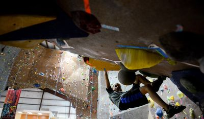 Ben Martin, 10, of Gainesville, Va. stays indoors and out of the heat as he exercises at Vertical Rock Indoor Climbing Center, Manassas, Va., Thursday, September 4, 2014. (Andrew Harnik/The Washington Times)