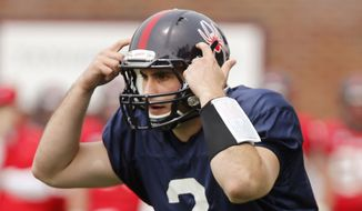 In this photo taken on April 19, 2014,  Richmond quarterback Michael Rocco gestures during a spring NCAA college football game  at UR Stadium, in Richmond, Va. Rocco who transferred from Virginia, will be one of the Spiders' game captains on Saturday when they play at Virginia. (AP Photo/Richmond Times Dispatch, Joe Mahoney)