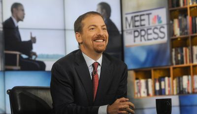 """In this  Aug. 31, 2014, photo released by NBC News, Chuck Todd, moderator of """"Meet the Press,"""" appears on set in Washington. (AP Photo/NBC, William B. Plowman)"""