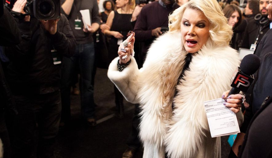 """FILE - In this Feb. 14, 2012 file photo, Joan Rivers tours backstage with her camera crew for E!'s """"Fashion Police,"""" before the Badgley Mischka show  during Fashion Week in New York. In the intense, high-stakes world of fashion, Joan Rivers helped change the game. Rivers, the raucous, acid-tongued comedian who crashed the male-dominated realm of late-night talk shows and turned Hollywood red carpets into danger zones for badly dressed celebrities,  died Thursday, Sept. 4, 2014. She was 81. Rivers was hospitalized Aug. 28, after going into cardiac arrest at a doctor's office. (AP Photo/John Minchillo, File)"""
