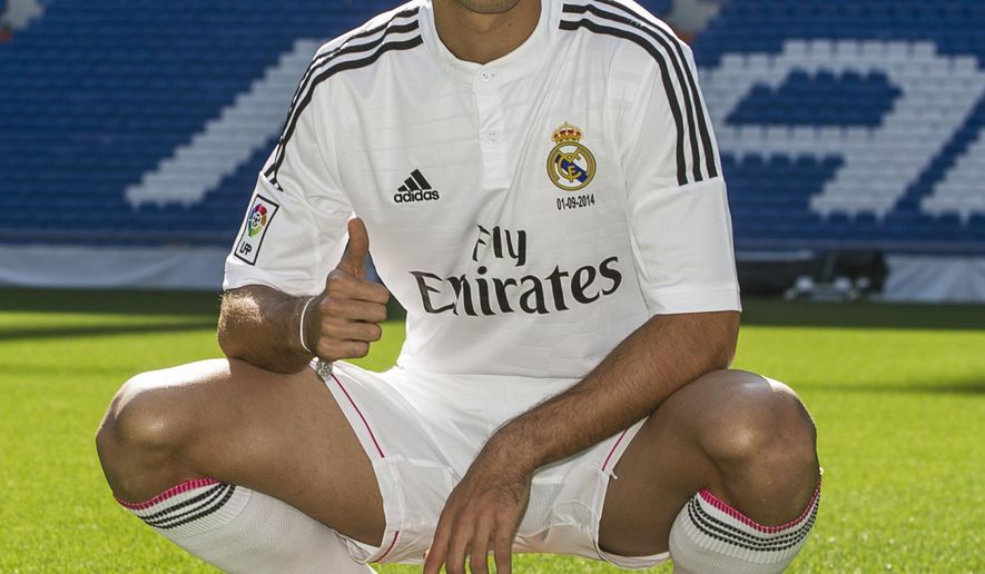 Mexico's international soccer player Javier Hernandez 'Chicharito', poses during his official presentation at the Santiago Bernabeu stadium in Madrid, Spain, Monday, Sept. 1, 2014, after signing for Real Madrid. (AP Photo/Andres Kudacki)