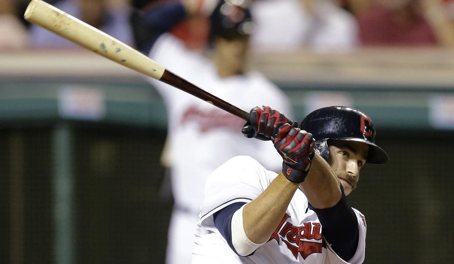Cleveland Indians' Lonnie Chisenhall hits an RBI single off Detroit Tigers starting pitcher Max Scherzer in the sixth inning of a baseball game, Thursday, Sept. 4, 2014, in Cleveland. Jason Kipnis scored on the play, and Chisenhall advanced to second. (AP Photo/Tony Dejak)
