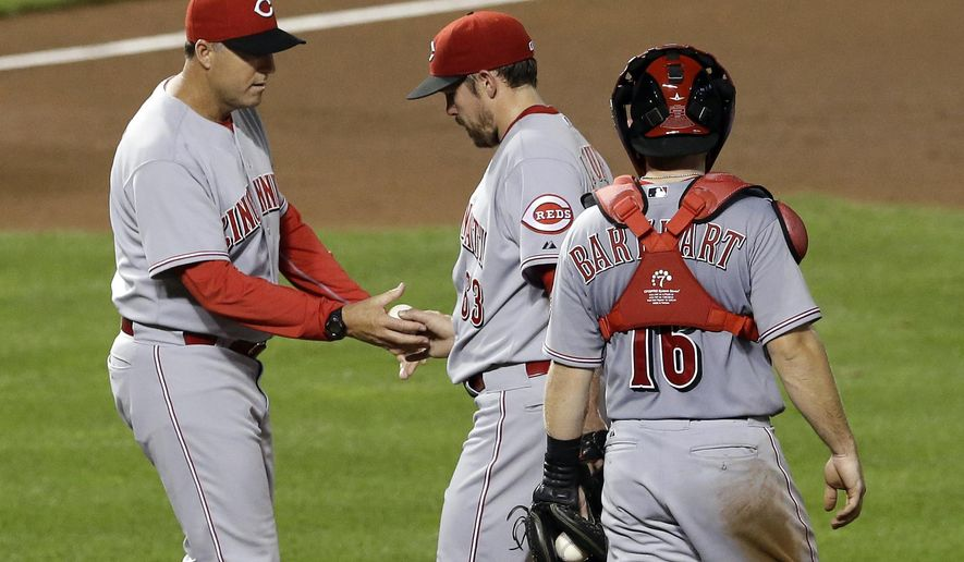 Cincinnati Reds manager Bryan Price, left, relieves relief pitcher Sam LeCure, center, in front of catcher Tucker Barnhart in the seventh inning of an interleague baseball game against the Baltimore Orioles, Thursday, Sept. 4, 2014, in Baltimore. Baltimore scored two runs on LeCure in the seventh and won 9-7. (AP Photo/Patrick Semansky)