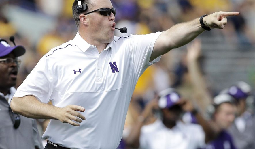 Northwestern head coach Pat Fitzgerald points as he yells to his team during the first half of an NCAA college football game against California in Evanston, Ill., Saturday, Aug. 30, 2014. (AP Photo/Nam Y. Huh)