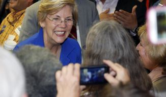 U.S. Sen. Elizabeth Warren, D-Mass., greets supporters during appearance at a campaign headquarters for U.S. Sen. Mark Udall, D-Colo., in northwest Denver suburb of Wheat Ridge, Colo., on Friday, Sept. 5, 2014. (AP Photo/David Zalubowski) ** FILE **