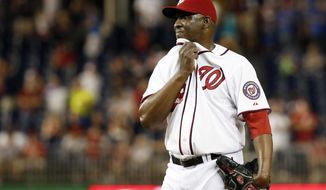 Washington Nationals relief pitcher Rafael Soriano pauses before being relieved during the ninth inning of a baseball game against the Philadelphia Phillies at Nationals Park, Friday, Sept. 5, 2014, in Washington. The Phillies won 9-8 in 11 innings. (AP Photo/Alex Brandon)