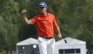 Billy Horschel reacts after putting out on the 18th hole to claim the lead after the third round of the BMW Championship golf  tournament in Cherry Hills Village, Colo., Saturday, Sept. 6, 2014. (AP Photo/David Zalubowski)