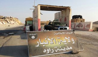 "FILE - In this Tuesday, July 22, 2014, file photo, a sign is posted at a checkpoint belonging to the Islamic State group, captured from the Iraqi Army, at the main entrance of Rawah, 175 miles (281 kilometers) northwest of Baghdad, Iraq. Arabic reads, ""Islamic State, the Emirate of Anbar, City of Rawah."" The U.S. and its allies are trying to hammer out a coalition to push back the Islamic State group in Iraq. But any serious attempt to destroy the militants or even seriously degrade their capabilities means targeting their infrastructure in Syria. That, however, is far more complicated. If it launches airstrikes against the group in Syria, the U.S. runs the risk of unintentionally strengthening the hand of President Bashar Assad, whose removal the West has actively sought the past three years. Uprooting the Islamic State, which has seized swaths of territory in both Syria and Iraq, would potentially open the way for the Syrian army to fill the vacuum. (AP Photo, File)"