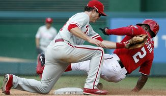 Washington Nationals center fielder Denard Span is tagged out by Philadelphia Phillies second baseman Chase Utley on the steal attempt of second base during the third inning of a baseball game at Nationals Park, Saturday, Sept. 6, 2014, in Washington. (AP Photo/Alex Brandon)