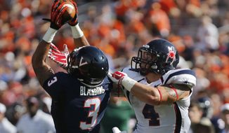 Virginia's Quin Blanding intercepts a pass intended for Richmond's Seth Fisher (4) during an NCAA college football game in Charlottesville ,Va., Saturday, Sept. 6, 2014. (AP Photo/Richmond Times-Dispatch, Joe Mahoney)