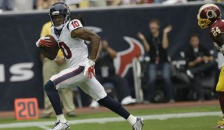 Houston Texans' DeAndre Hopkins (10) scores against the Washington Redskins on a 76-yard reception during the second quarter of an NFL football game Sunday, Sept. 7, 2014, in Houston. (AP Photo/David J. Phillip)