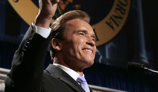 FILE - In this Jan. 5, 2007 file photo, Gov. Arnold Schwarzenegger gives the crowd a thumbs up after his inaugural speech in Sacramento, Calif. Schwarzenegger is returning to the state capital Monday, Sept. 8, 2014, for two high-profile public events to discuss California's fight against climate change and unveil his official portrait at the Capitol.(AP Photo/Rich Pedroncelli, File)